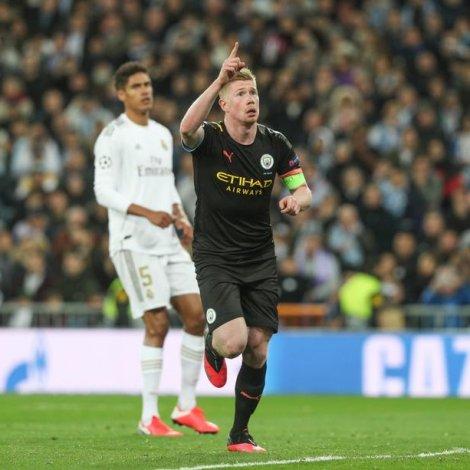 Kevin De Bruyne skoraði fyrra málið fyri City - Real Madrid vann eisini við tveimum málum (Mynd: EPA)